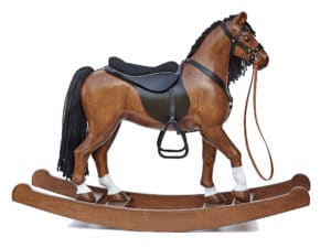 Big wooden rocking horse, colour chestnut with a leather harness and saddle