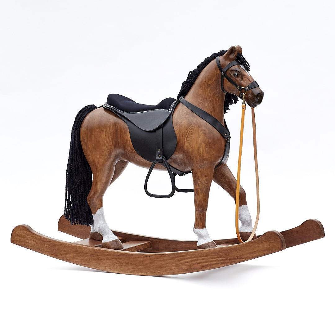 Elegant big horse Royal Spinel made from massive wood placed on rockers