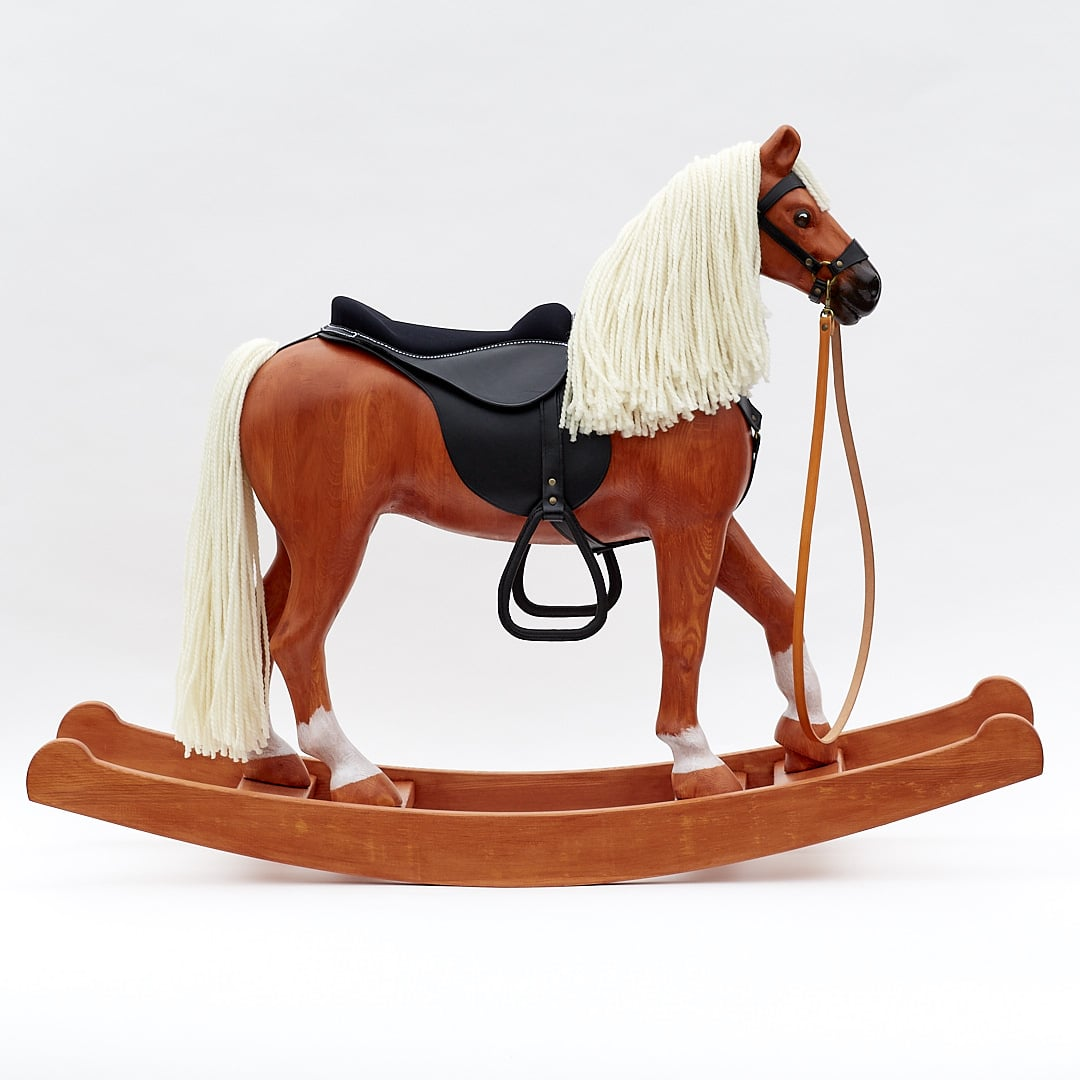 Royal Spinel chestnut coloured wooden rocking horse comes equipped with a leather harness and a saddle