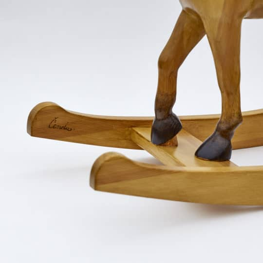 Middle sized wooden rocking horse, tan colors