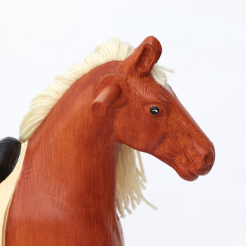 Detail on head of chestnut middle sized wooden rocking horse