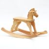 Medium Rocking horse mad of pine wood with natural surface finish and painted eye