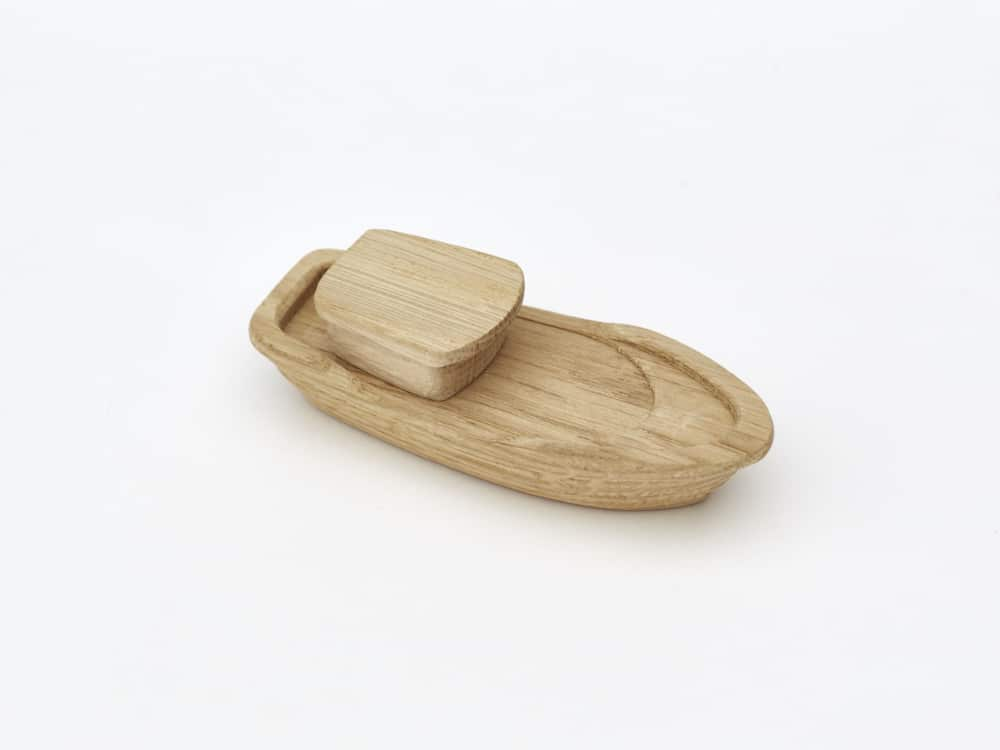 Small wooden boat with cabin