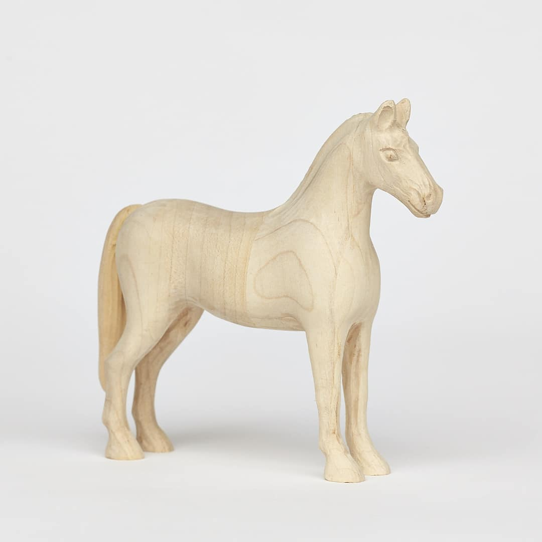 Small wooden horse made from maple